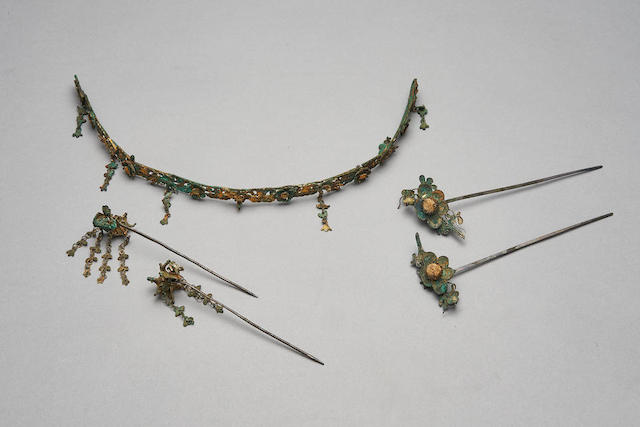 Suite of gilt silver filigree headdress and hairpins, possibly Liao dynasty. Image from Bonhams.