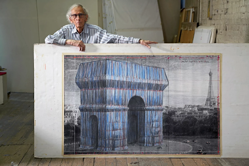 Christo with a preparatory drawing for L'Arc de Triomphe, Wrapped in 2019. Image by Wolfgang Volz. © 2019 Christo and Jeanne-Claude Foundation.