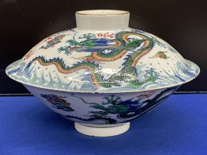 This graceful porcelain dragon bowl with Yongzheng mark sold for $200,000 (including buyer's premium).