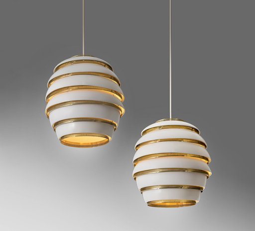 """Alvar Aalto, pair of """"Beehive"""" pendant lights, 1953. Image from Annmaris Auctions/PIASA."""